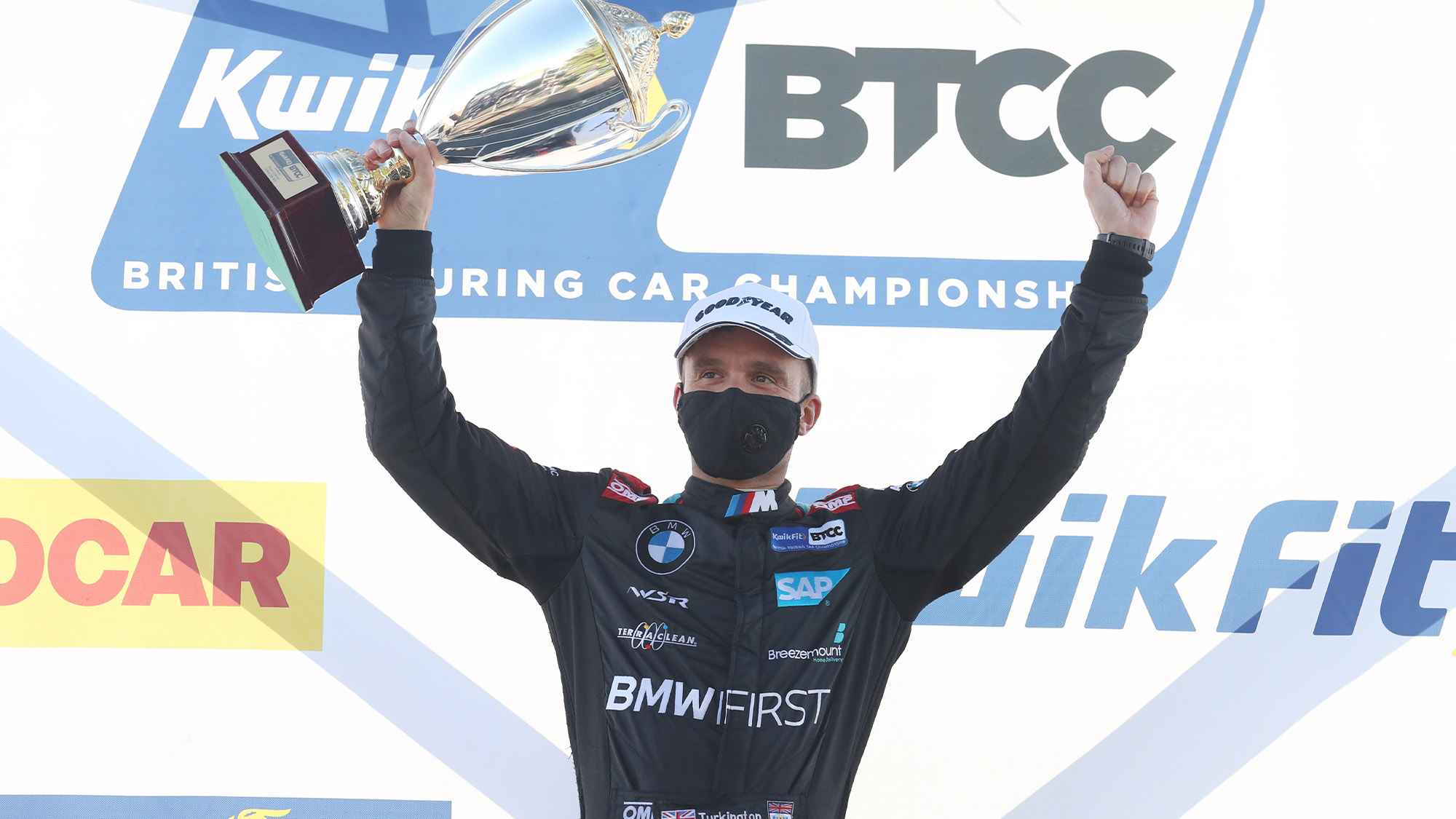 Colin Turkington celebrates victory at Snetterton on the BTCC podium in 2020