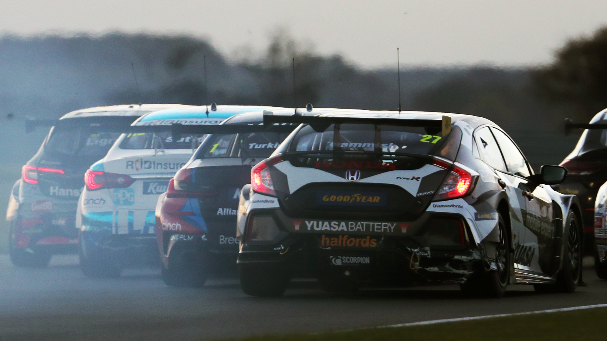 Four cars battle at Snetterton in the 2020 BTCC round