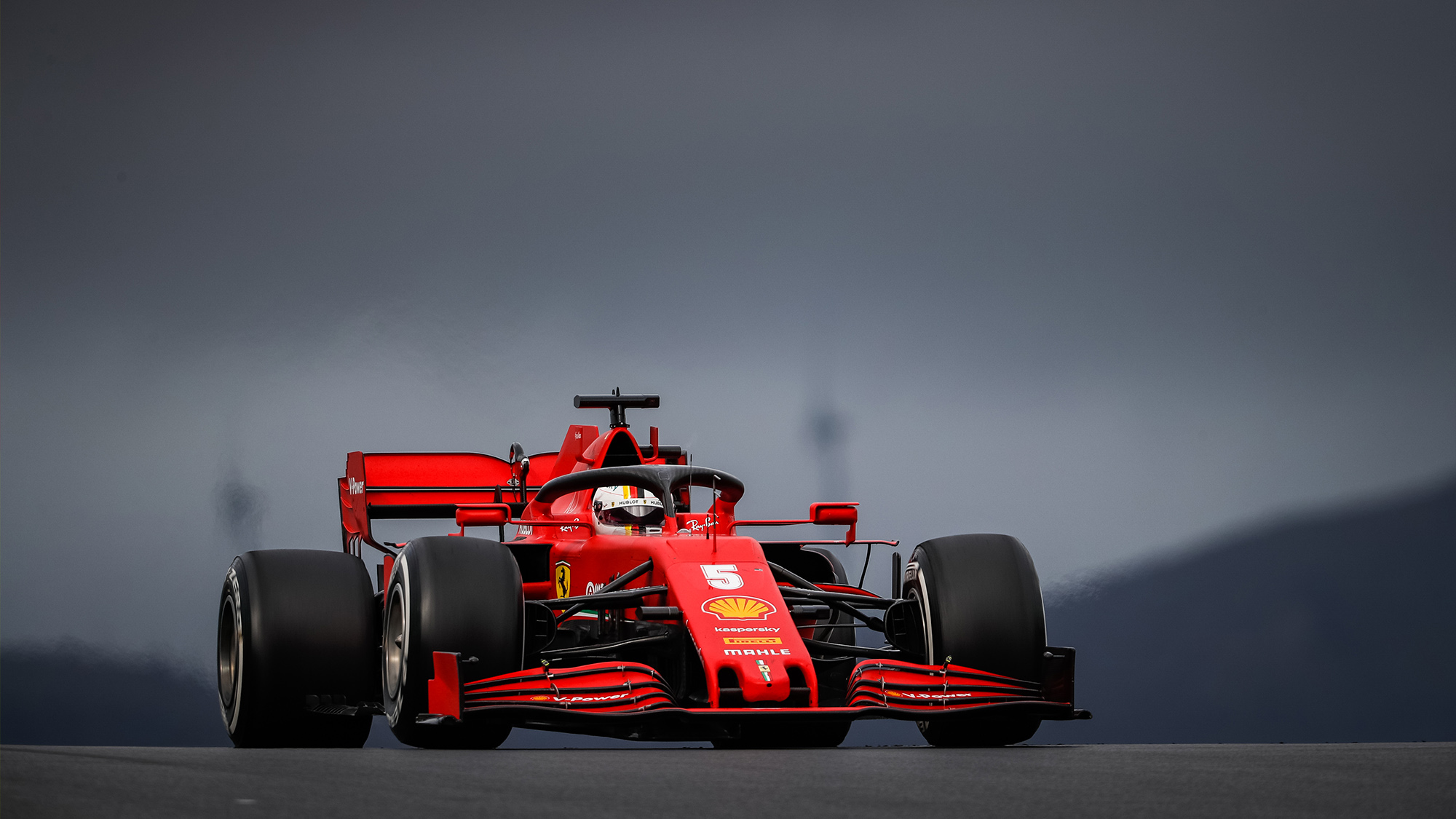 Sebastian Vettel driving under a stormy sky at the 2020 F1 Portuguese Grand Prix at Portimao