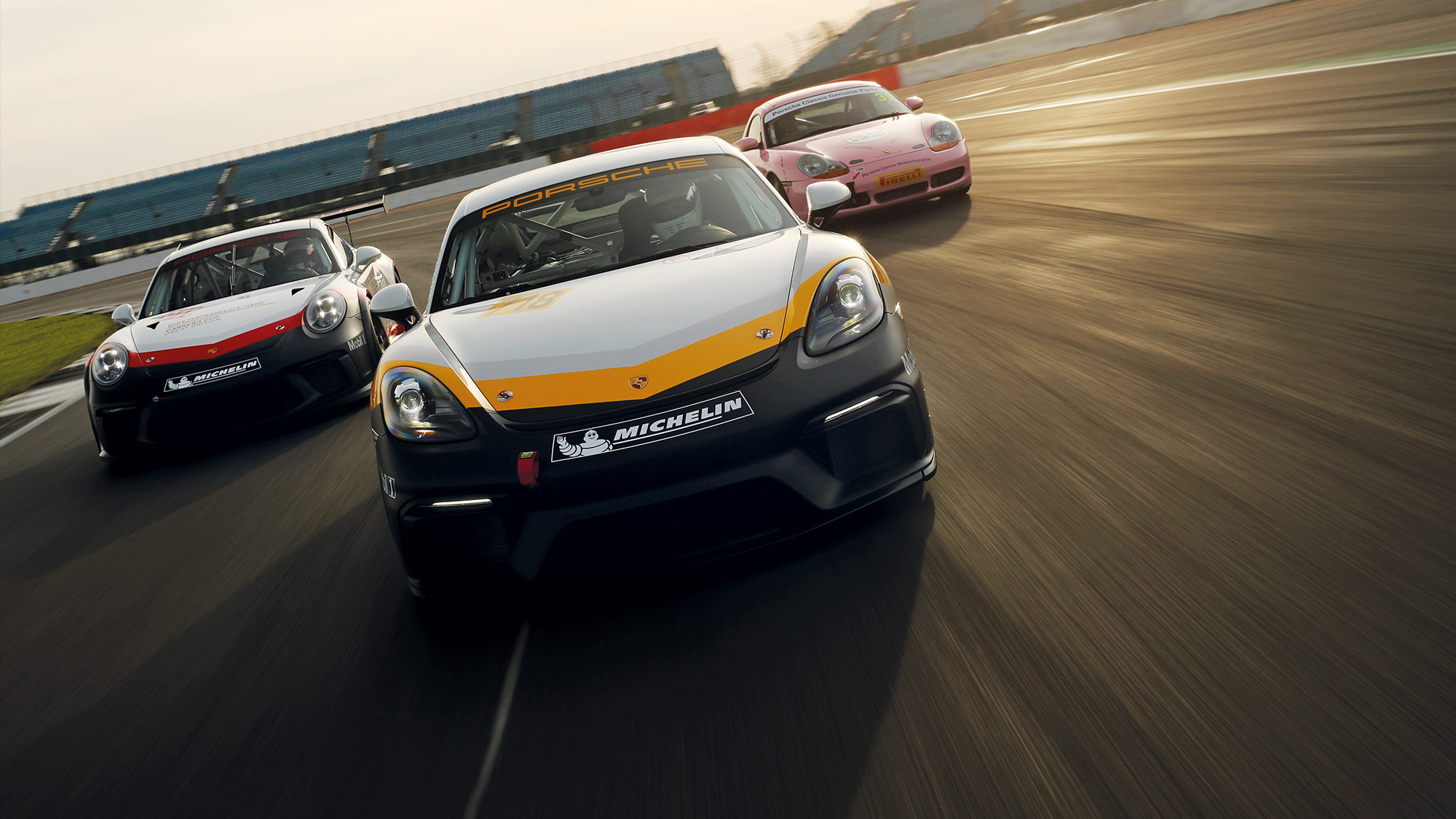 Porsche 986 Boxster S, Cayman GT4 and 911 Gt3 Cup on track at SIlverstone - front