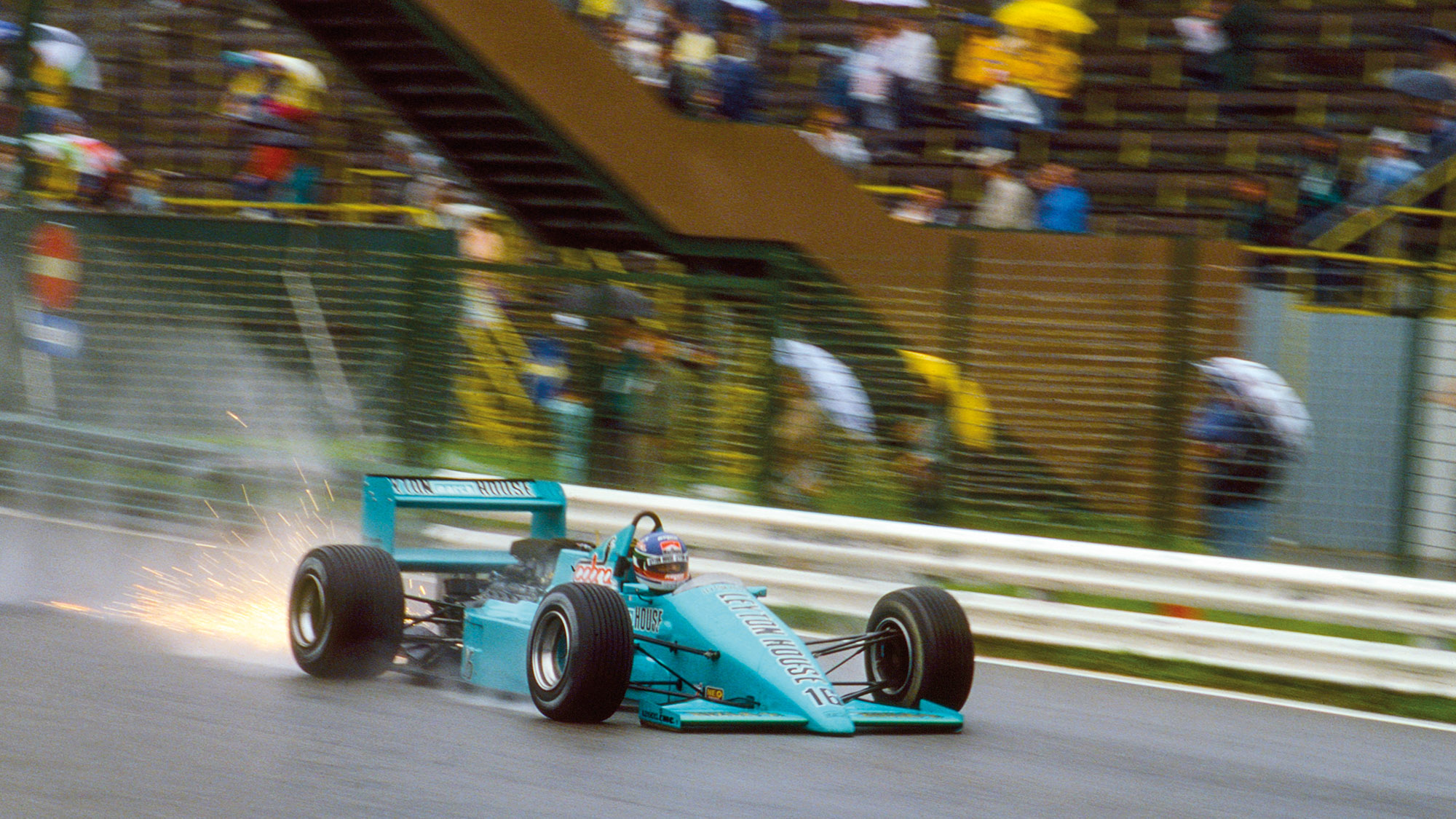 Sparks fly from Ivan Capelli's March 871 at the 1987 Austrian Grand prix
