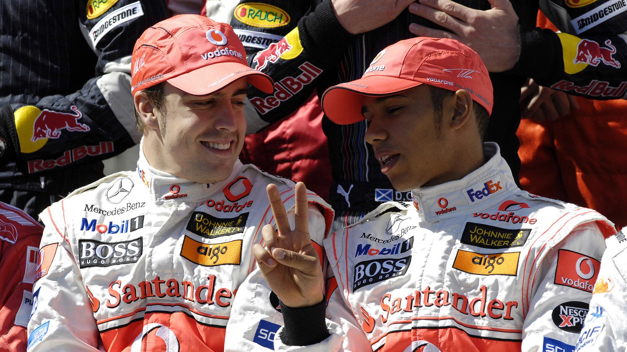 Lewis Hamilton talks to his McLaren team-mate Fernando Alonso