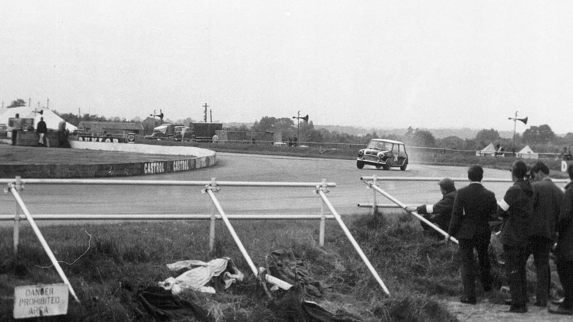 Mini Cooper at Copse Corner during the 1965 British Grand Prix meeting at Silverstone