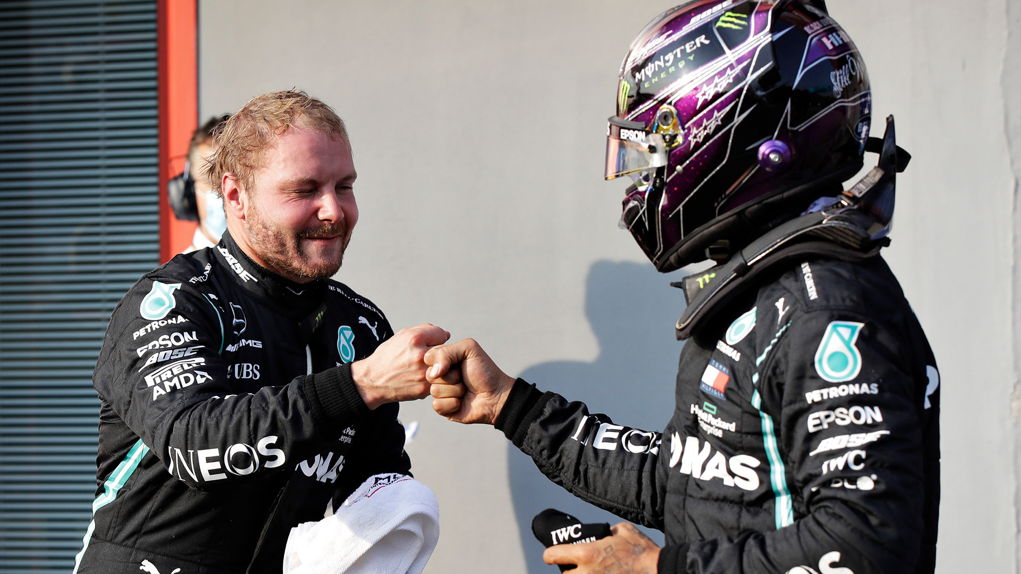 Valtteri Bottas and Lewis Hamilton bump fists at imola after qualifying for the 2020 F1 Emilia Romagna Grand Prix