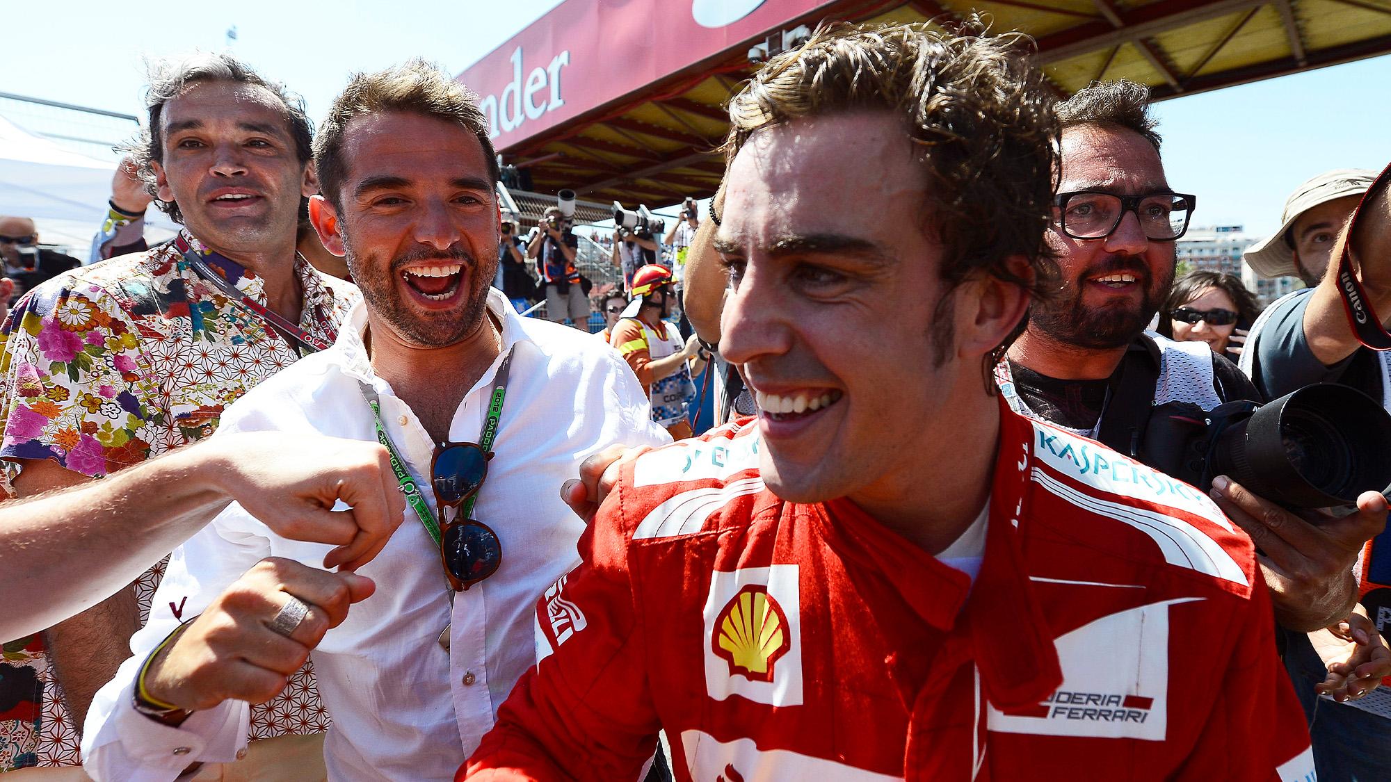 Fernando Alonso celebrates winning the 2012 European GP in Valencia