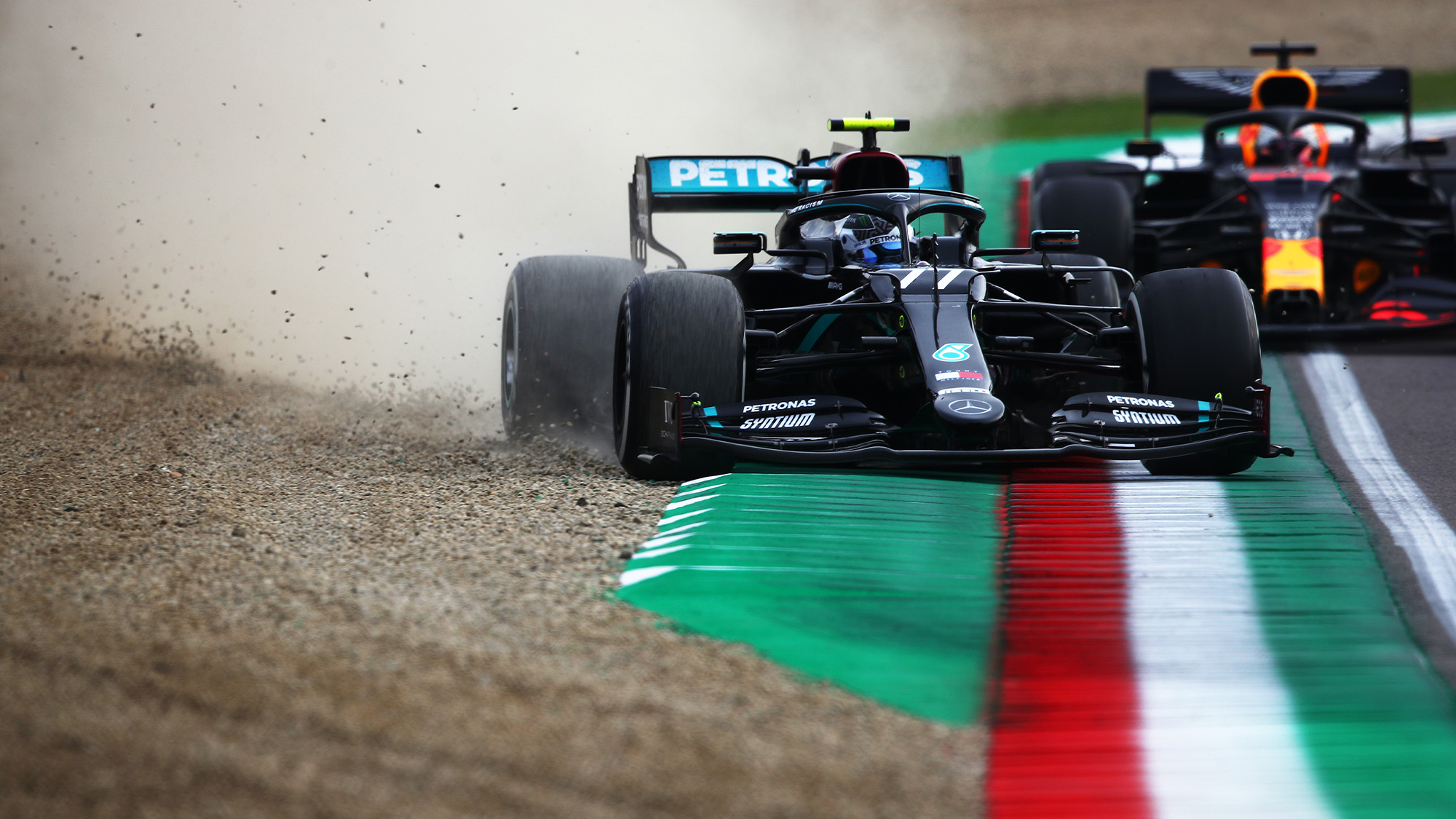 Valtteri Bottas' Mercedes runs wide onto the gravel at Imola as Max Verstappen's Red Bull looms behind during the 2020 F1 Emilia Romagna Grand Prix