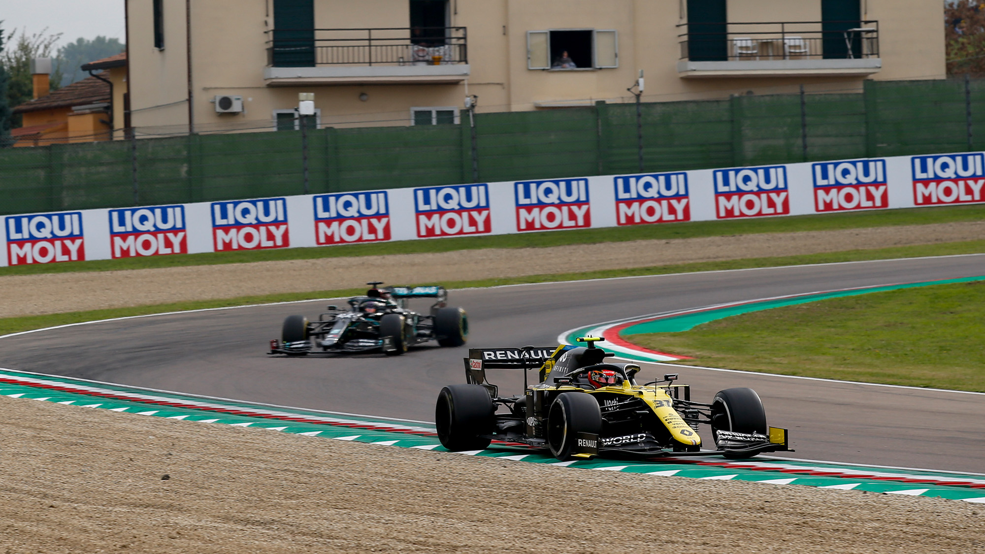 Lewis Hamilton comes up to lap the renault of Esteban Ocon at the 2020 F1 Emilia Romagna Grand Prix