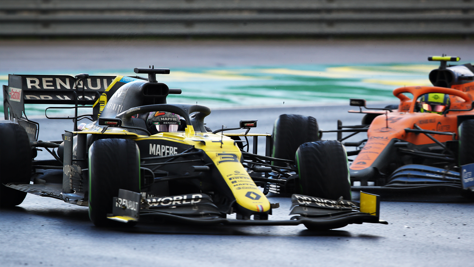 Daniel Ricciardo spins his Renault in front of Lando Norris' McLaren during the 2020 F1 Turkish Grand Prix at Istanbul Park