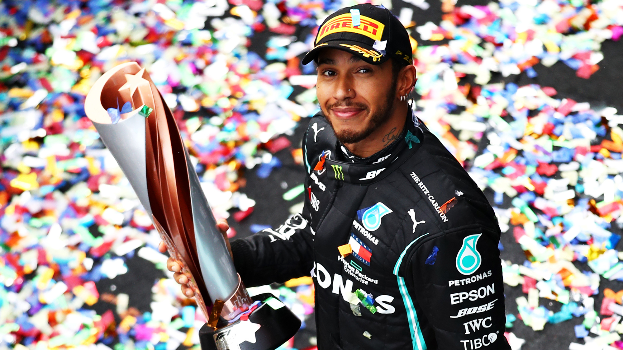 Lewis Hamilton holds the winner's trophy from the 2020 F1 Turkish Grand Prix where he won his 7th F1 world championship