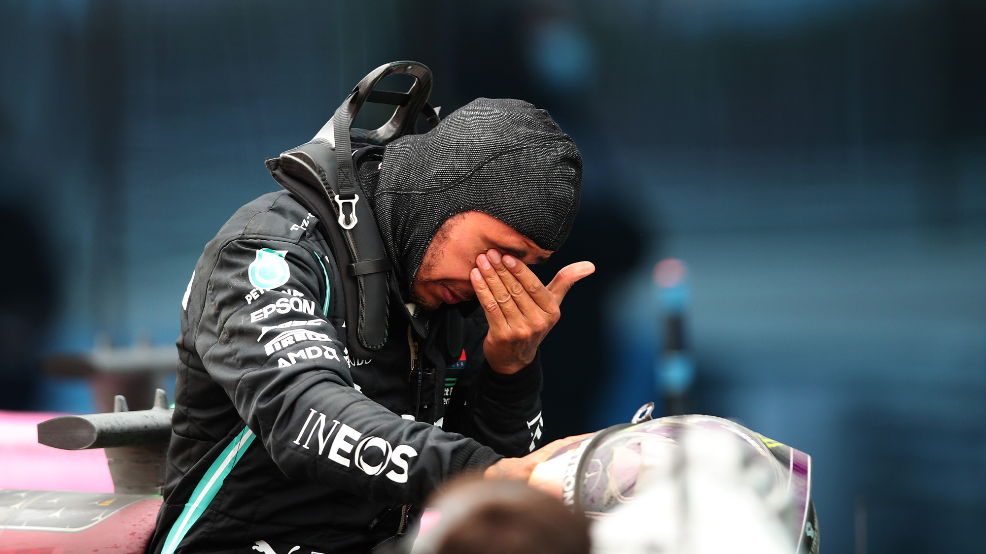 An emotional Lewis Hamilton wipes his eyes after winning the 2020 f1 Turkish Grand Prix