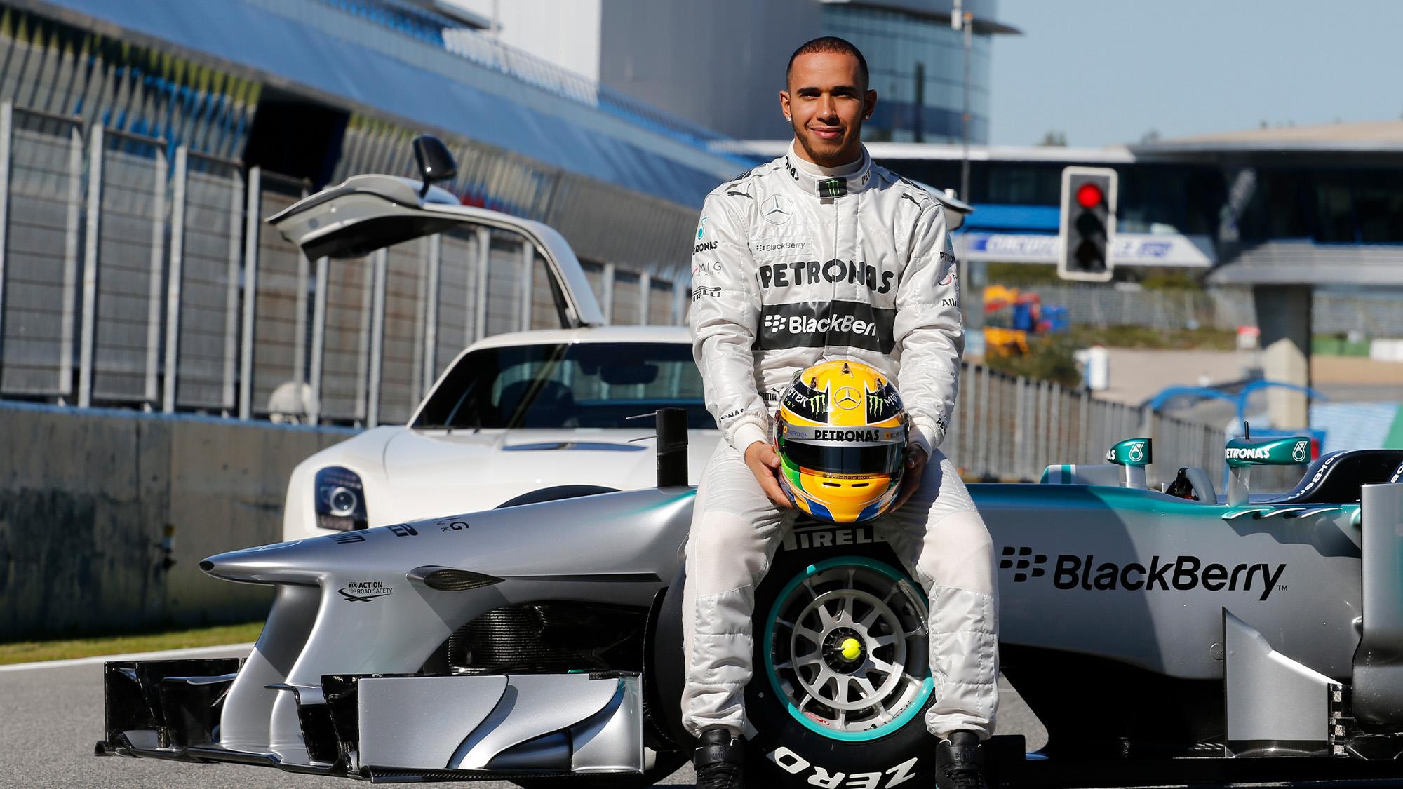Lewis Hamilton sits on the Mercedes W04 2013 F1 car