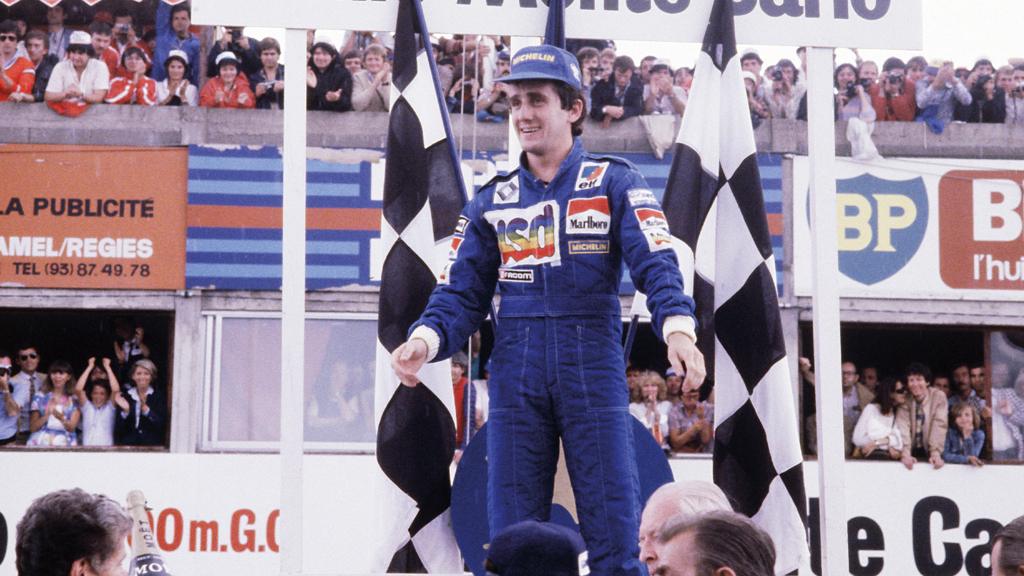 Alain Prost celebrates winning the 1981 French Grand Prix at Paul Ricard for Renault