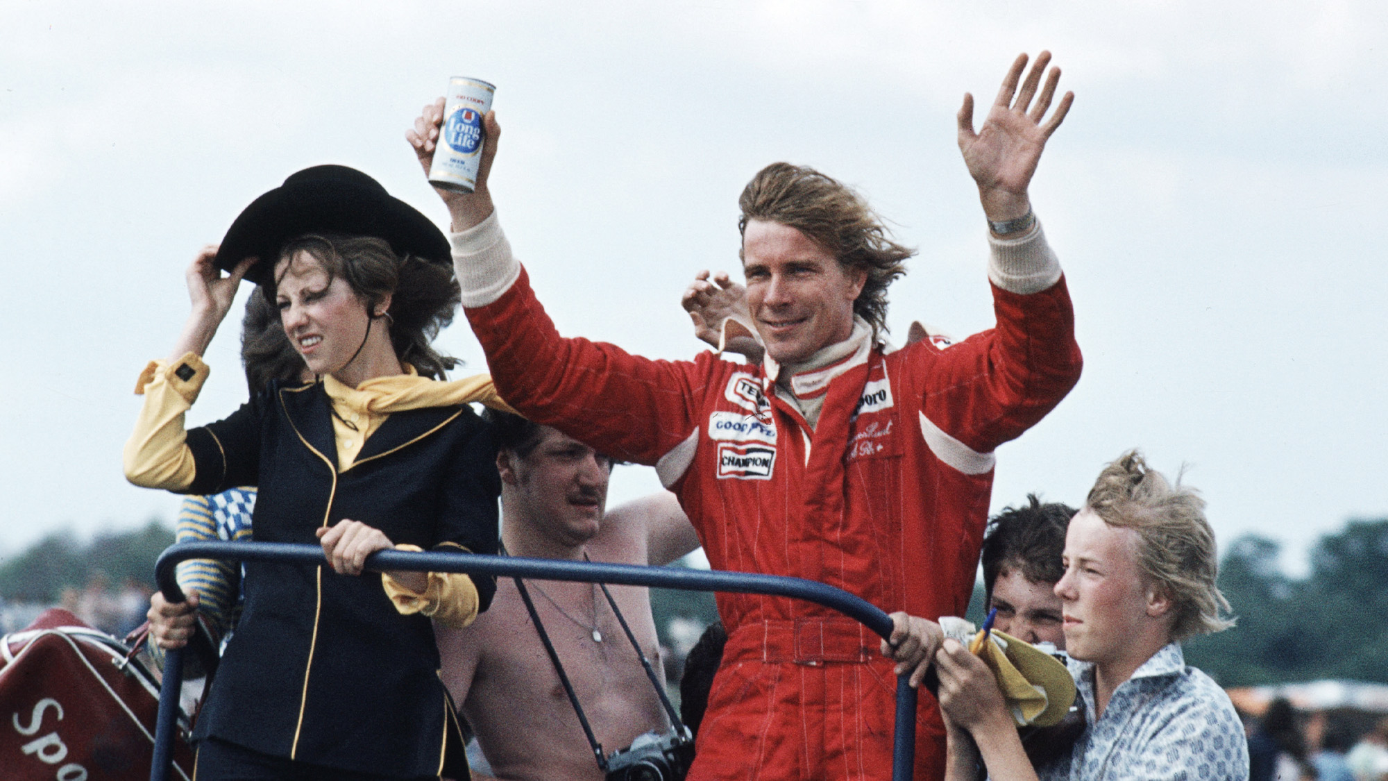 James Hunt celebrates winning the 1977 F1 British Grand Prix at Silverstone with a can of beer