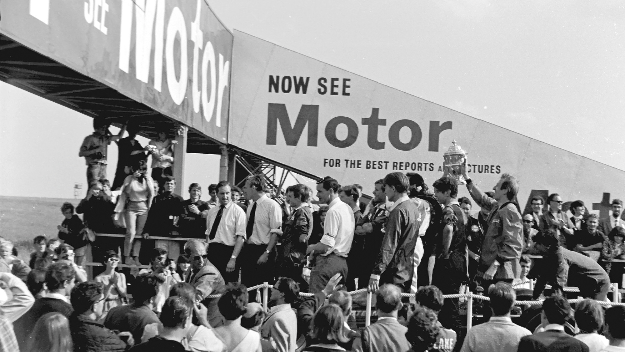 Jim Clark in the middle of the crowd after winning the 1967 British Grand Prix