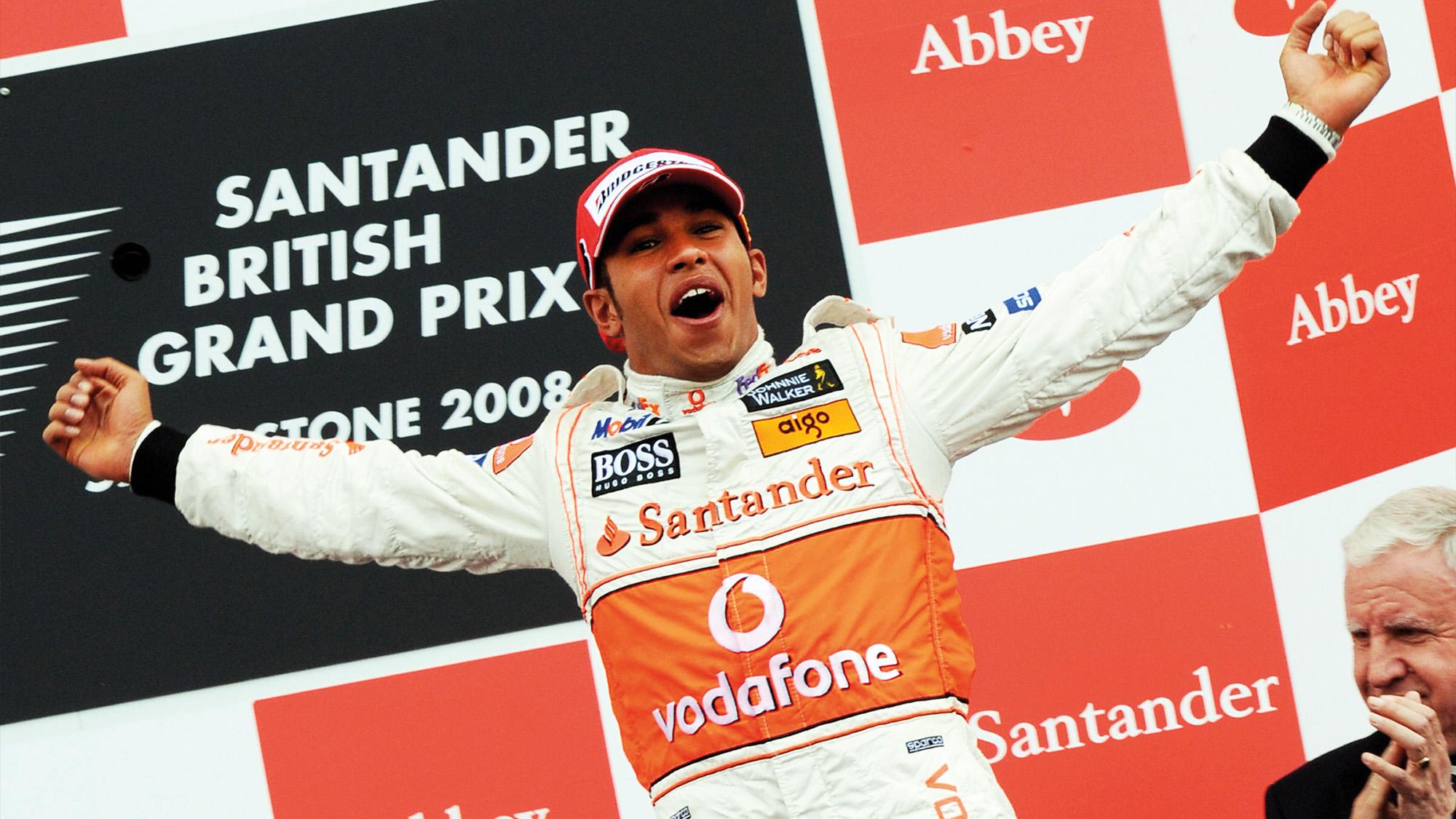 Lewis Hamilton on the podium after winning the 2008 F1 British Grand Prix with McLaren