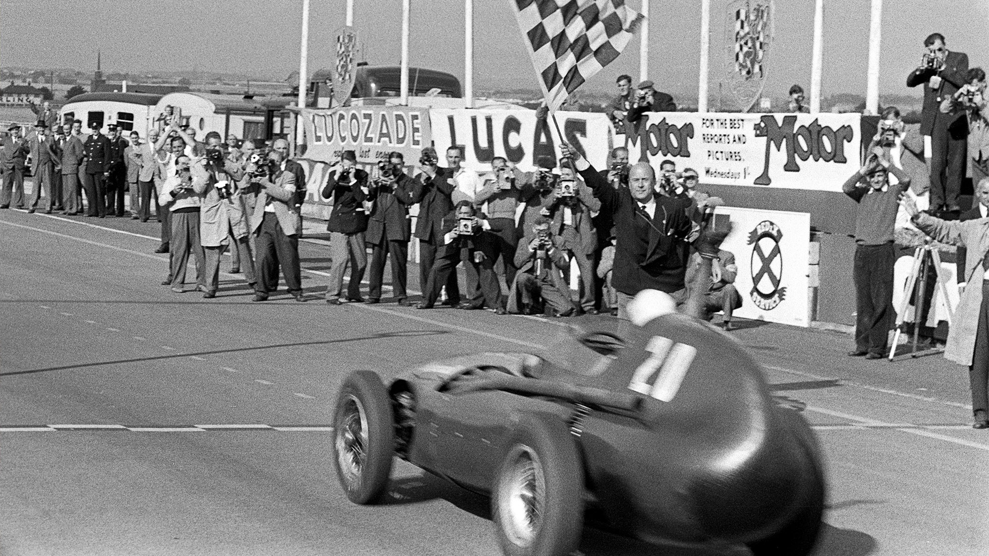 Stirling Moss winning the 1957 British Grand Prix at Aintree in his Vanwall