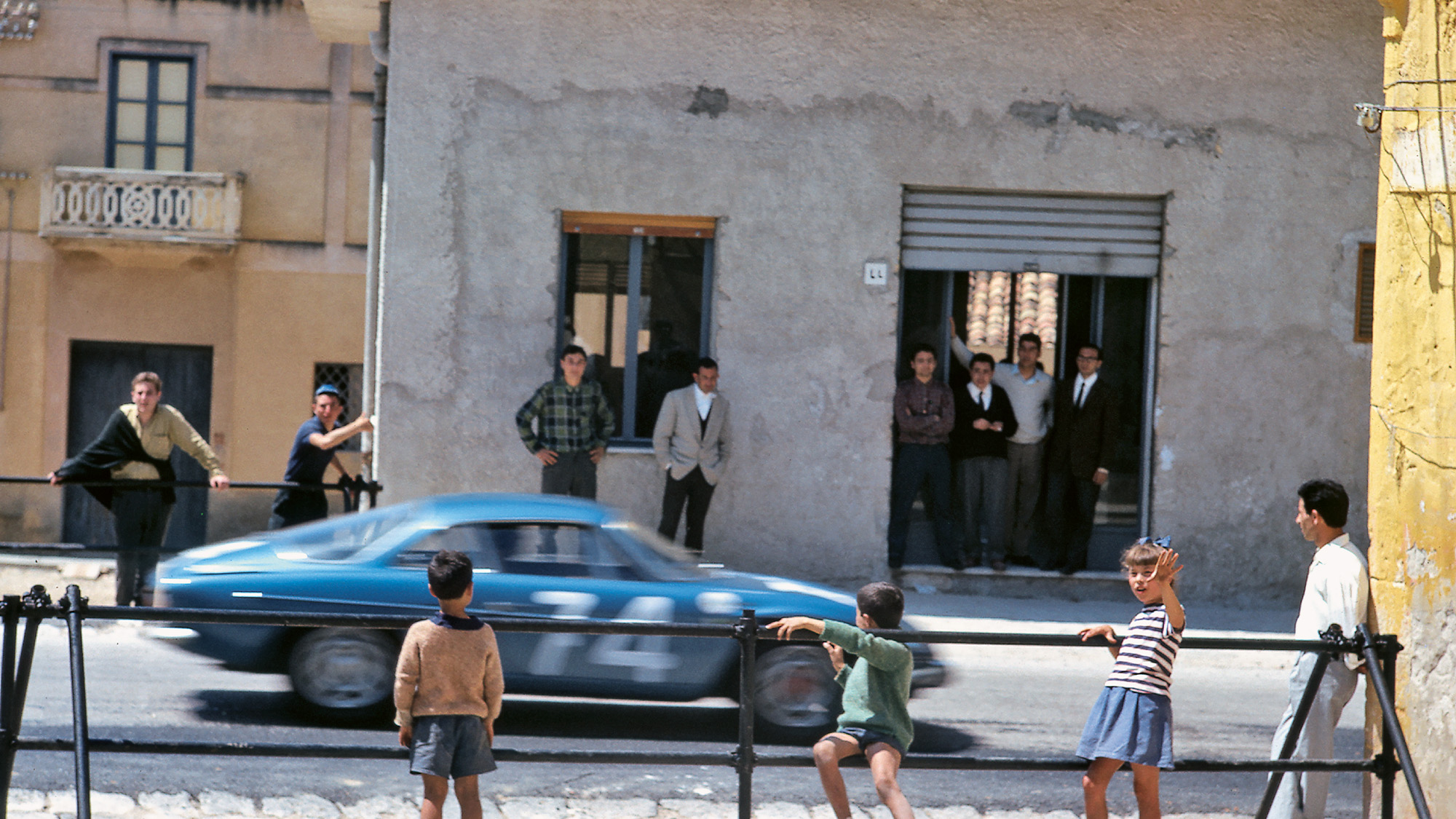 Crowds watch the Alpine A110 of Jean-Pierre Hanrioud and Jean-Francois Piot on the 1966 Targa Florio