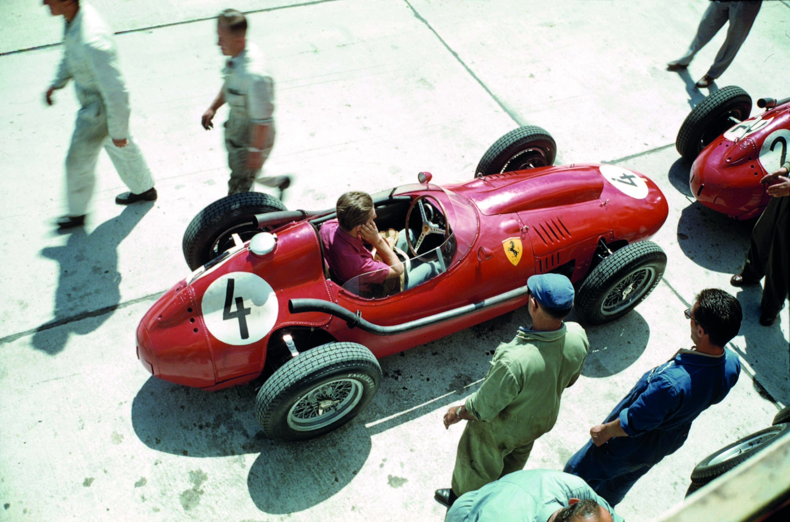 Wolfgang-von-Trips-covers-his-ears-while-sitting-in-his-Ferrari-Dino-246-behind-Peter-Collins-car-at-the-1958-German-Grand-Prix-at-the-Nurburgring
