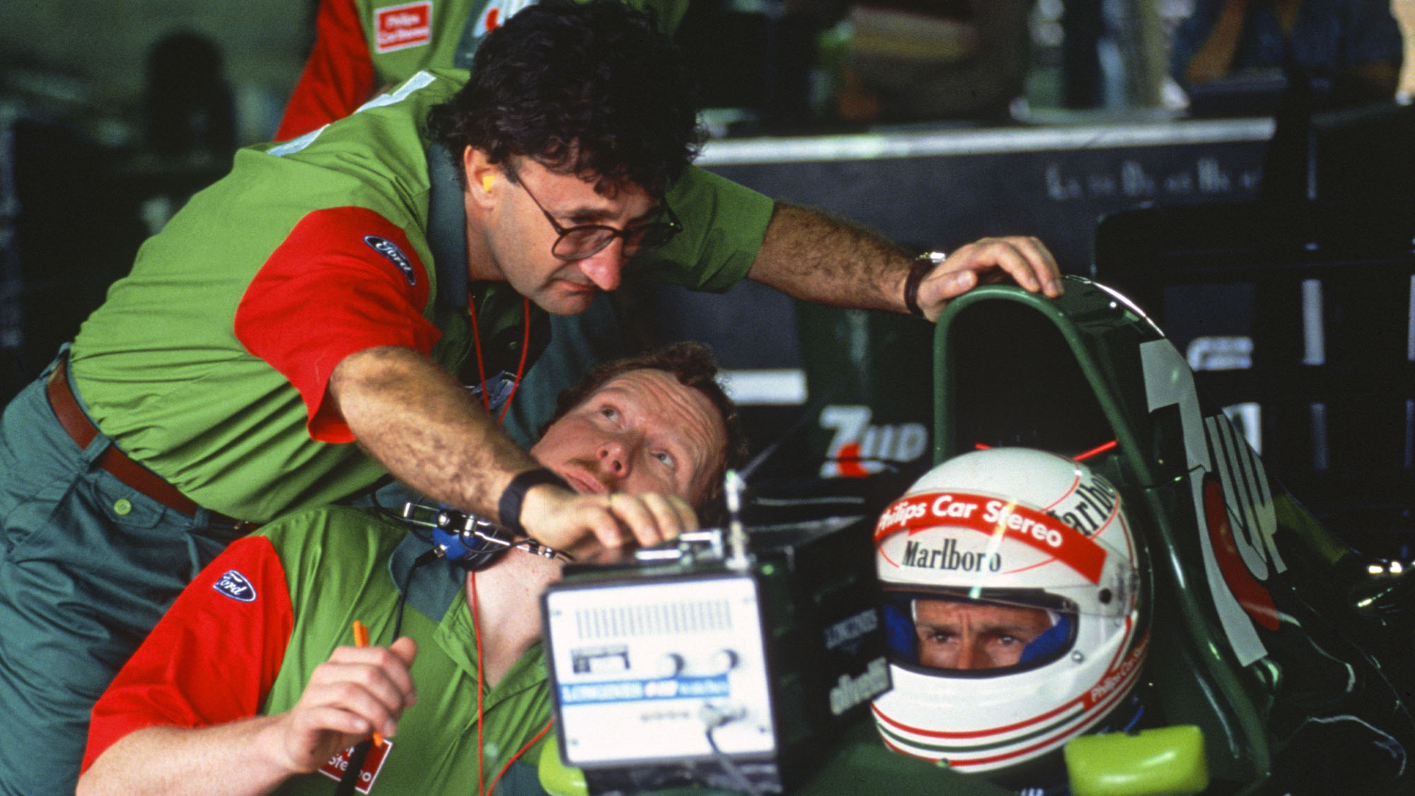 Jordan-Ford team principal Eddie Jordn, team manager Trevor Foster and Andrea de Cesaris in the pits during practice for the 1991 Brazilian Grand Prix in Interlagos. Photo: Grand Prix Photo