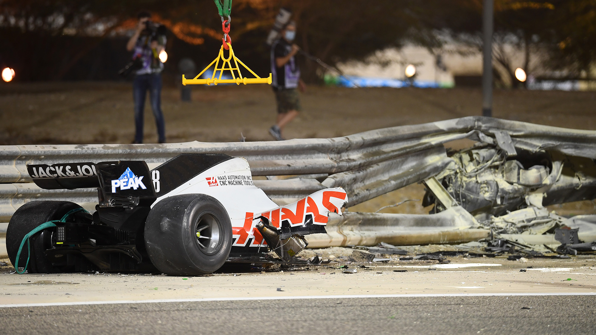 The wreckage of Romain Grosjean's Haas at the 2020 f1 Bahrain Grand prix