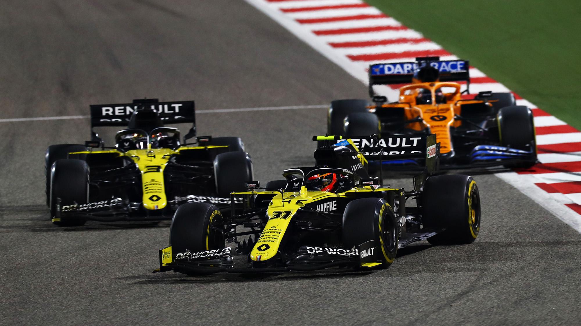 Caros Sainz's McLaren behind the Renaults of Esteban Ocon and Daniel Ricciardo