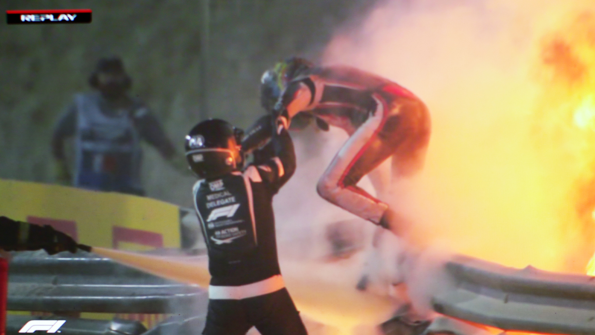 Romain Grosjean escapes the fire of his Haas wreckages at the 2020 F1 Bahrain Grand Prix