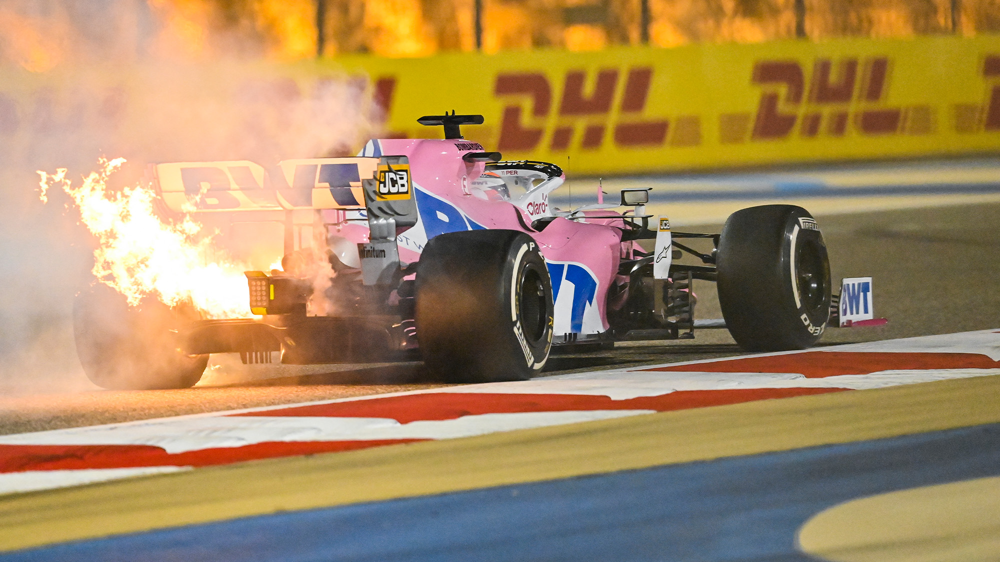 The engine on the Racing Point of Sergio Perez expires in flames at the 2020 F1 Bahrain Grand prix