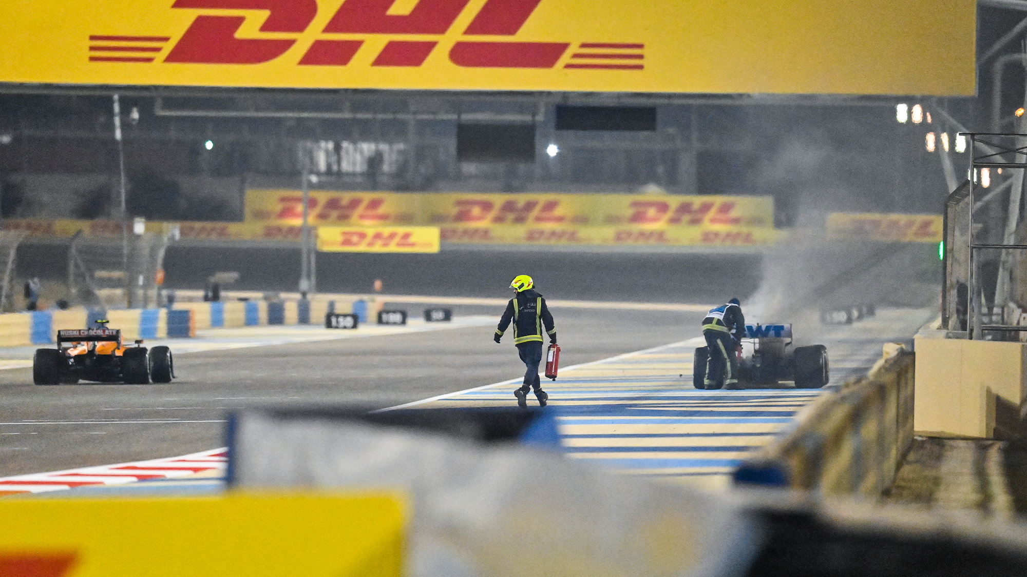 Lando Norris passes a marshal who had run across the track at the 2020 F1 Bahrain Grand Prix