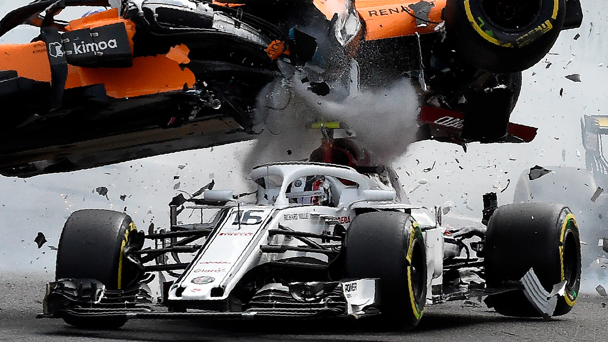 Fernando Alonso's McLaren flies over the Alfa Romeo of Charles Leclerc at the 2018 Belgian Grand Prix