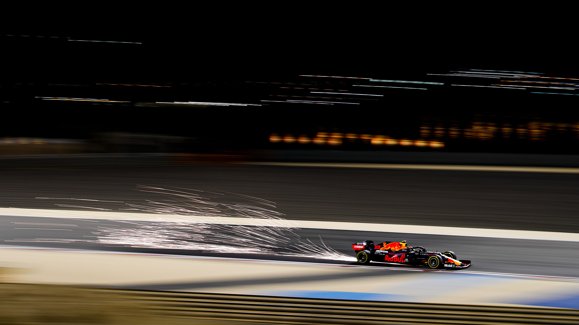 Sparks fly from Alex Albon's Red Bull during Sakhir Grand Prix practice