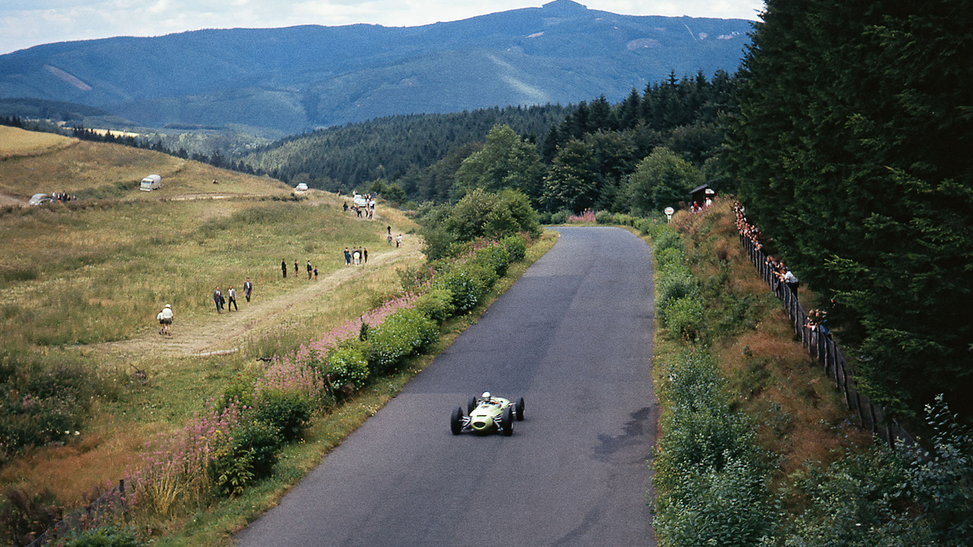 Jim Hall is but a tiny dot on the Eifel landscape as he races his Lotus-BRM 24 at the Nürburgring in 1963
