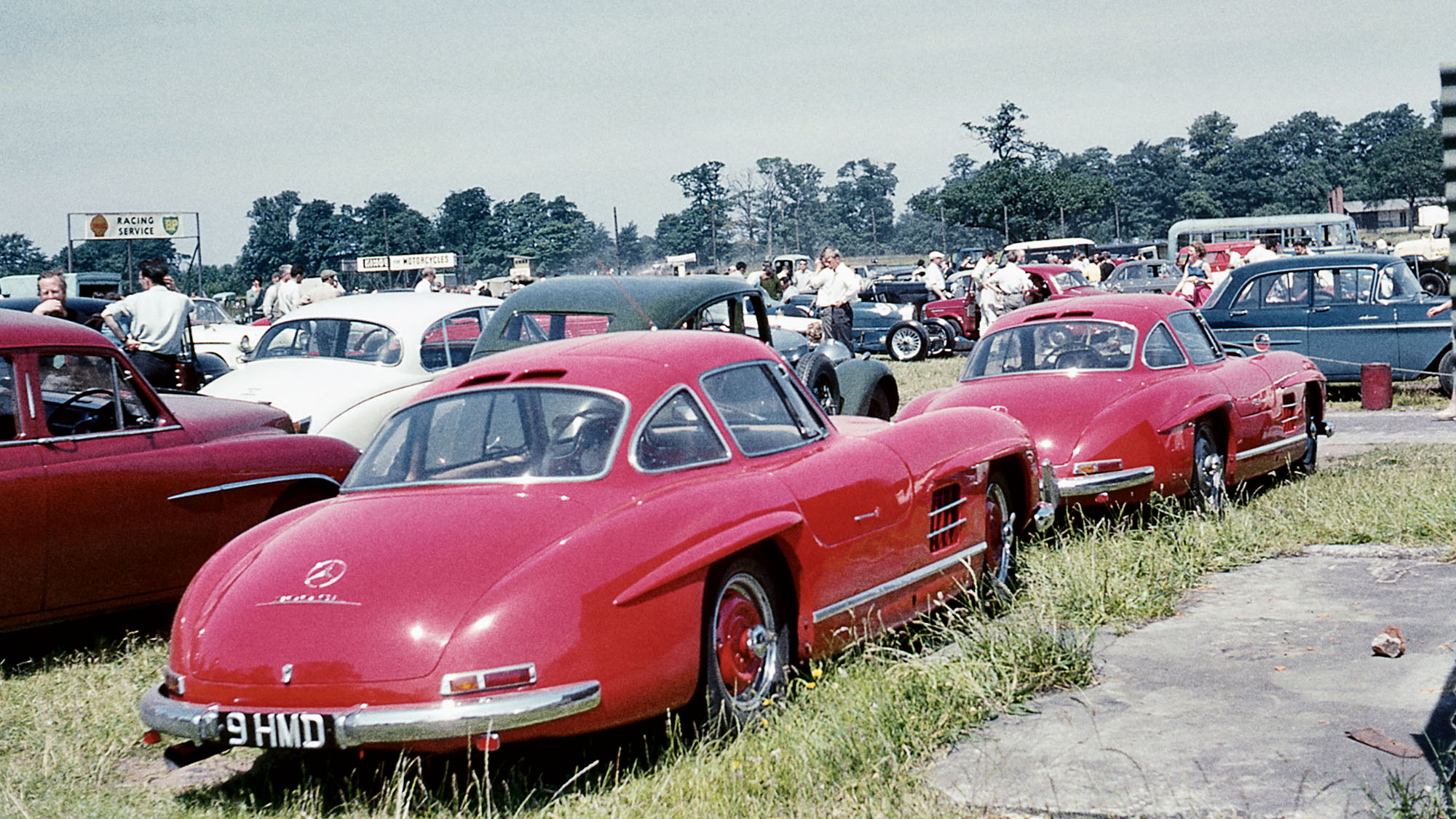 Not your average carpark: a pair of red Mercedes-Benz 300 SL Gullwings sit outside Oulton Park