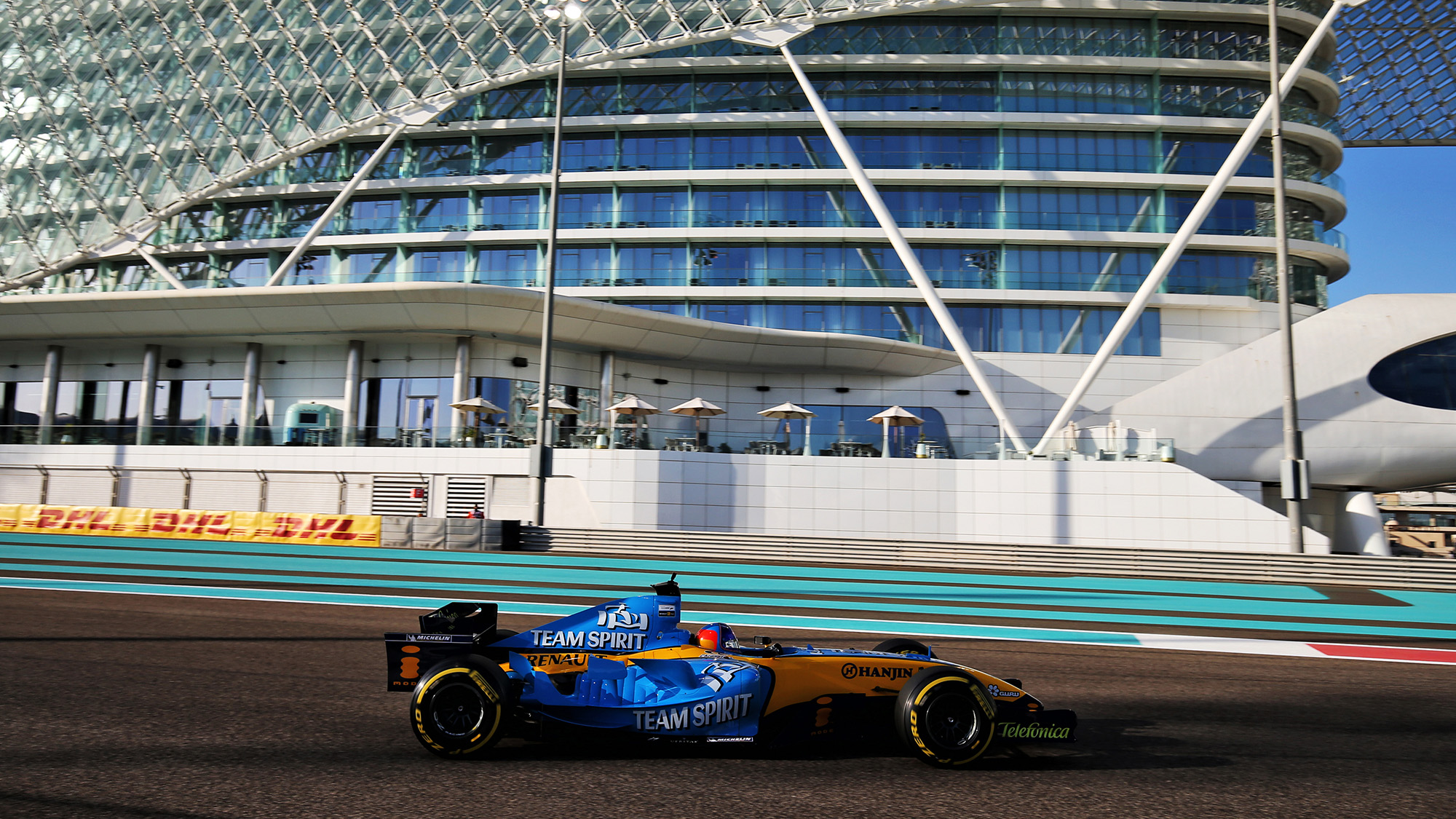 Fernando Alonso oin the Renault R25 at Abu Dhabi in 2020