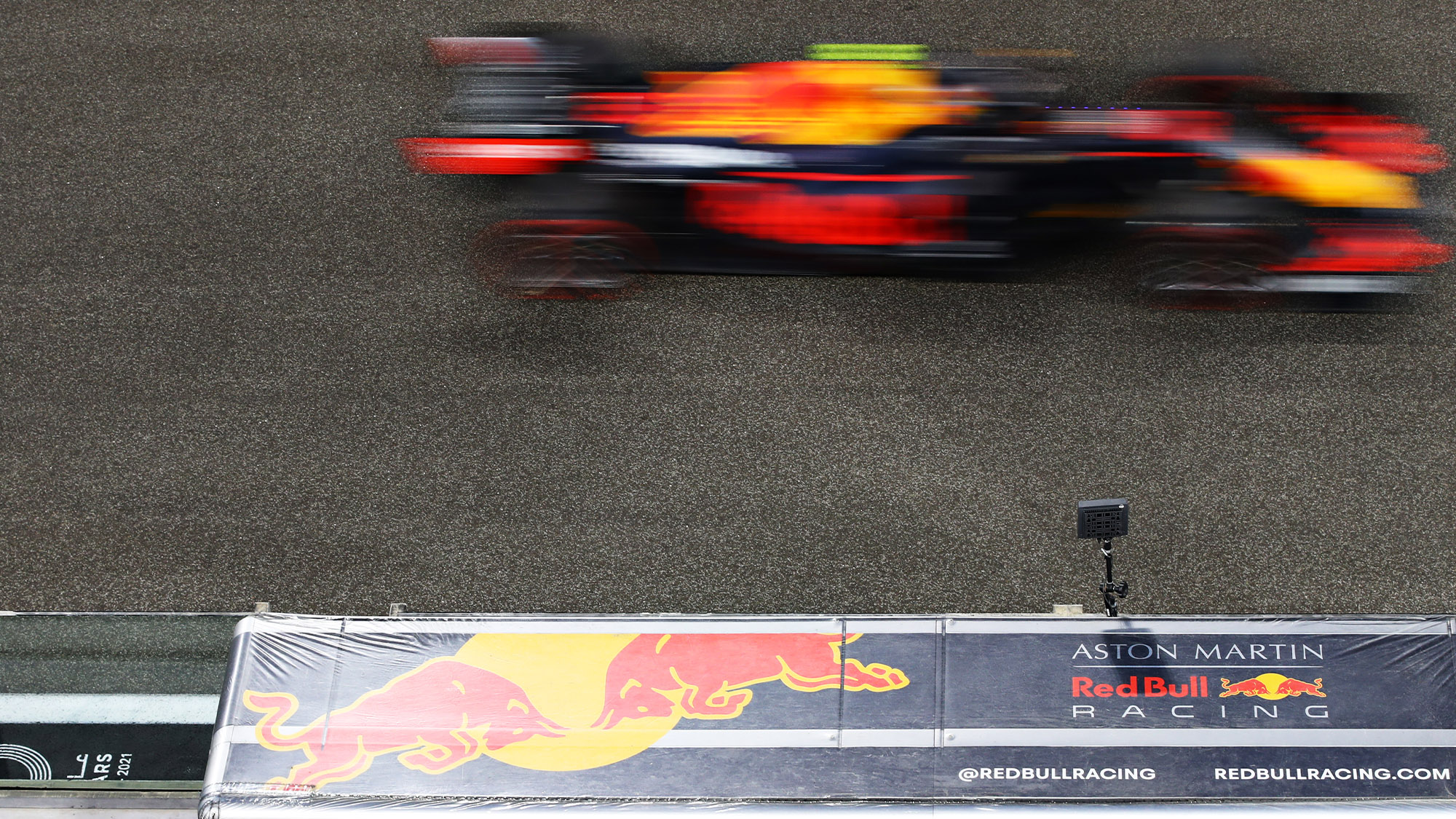 Alex Albon's Red Bull is a blur as it passes the pitwal at the 2020 Abu Dhabi GP