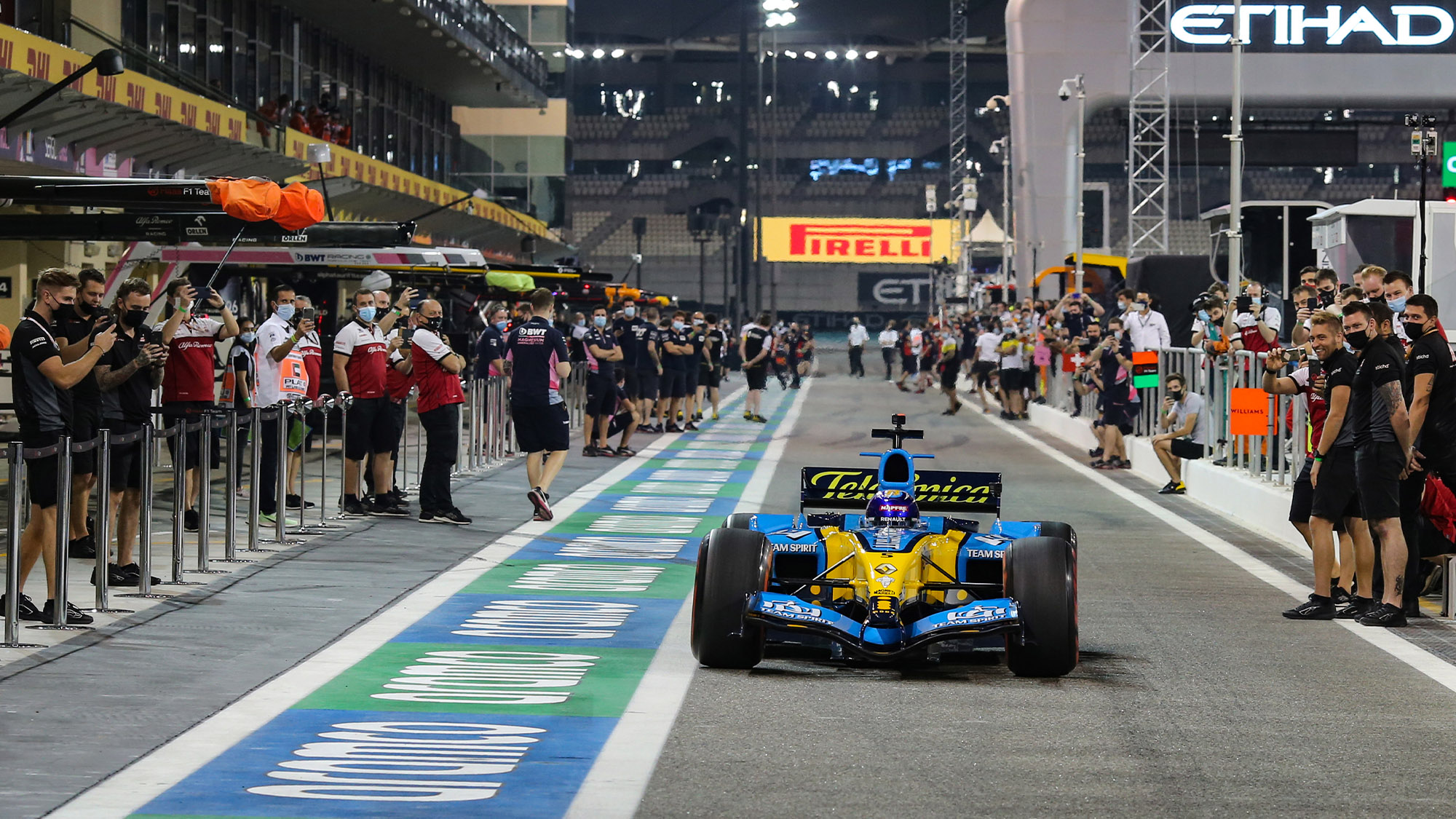 Fernando Alonso drives the Renault R25 down the Abu Dhabi pitlane in 2020
