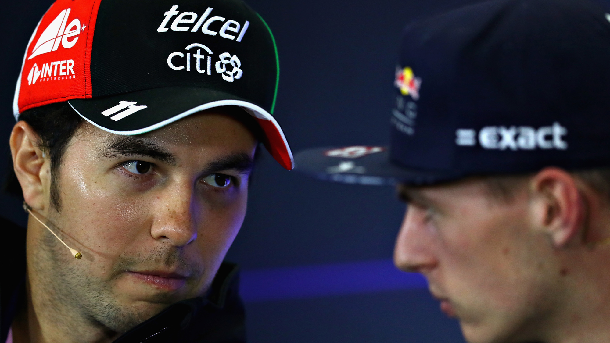 Sergio Perez looks towards Max Verstappen