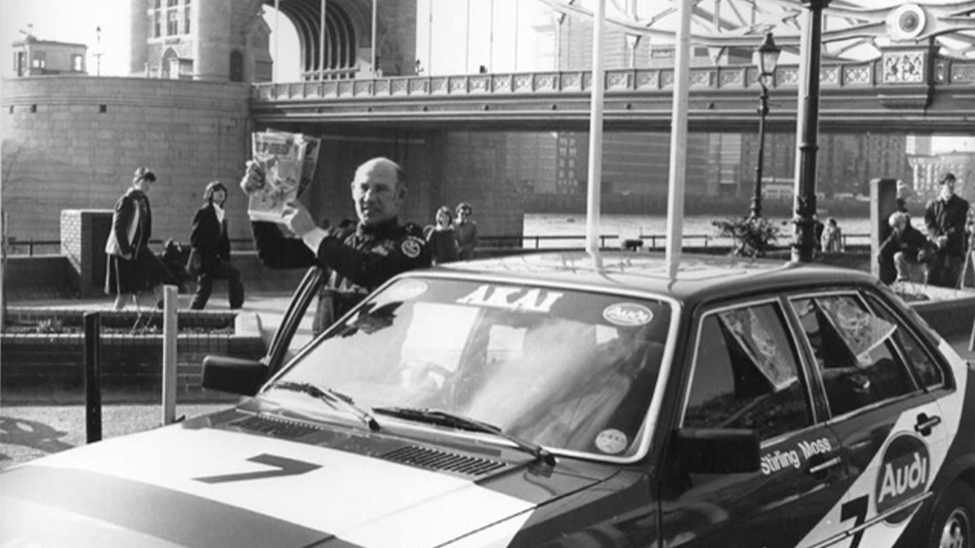 Stirling Moss at Tower Bridge with Speed comic
