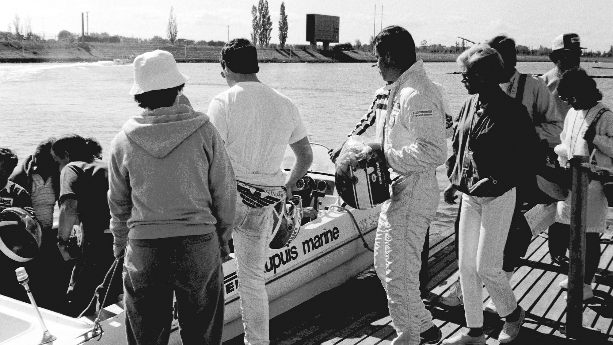 Derek Warwick and Patrick Tambay board a boat for the 1986 Canadian Grand Prix