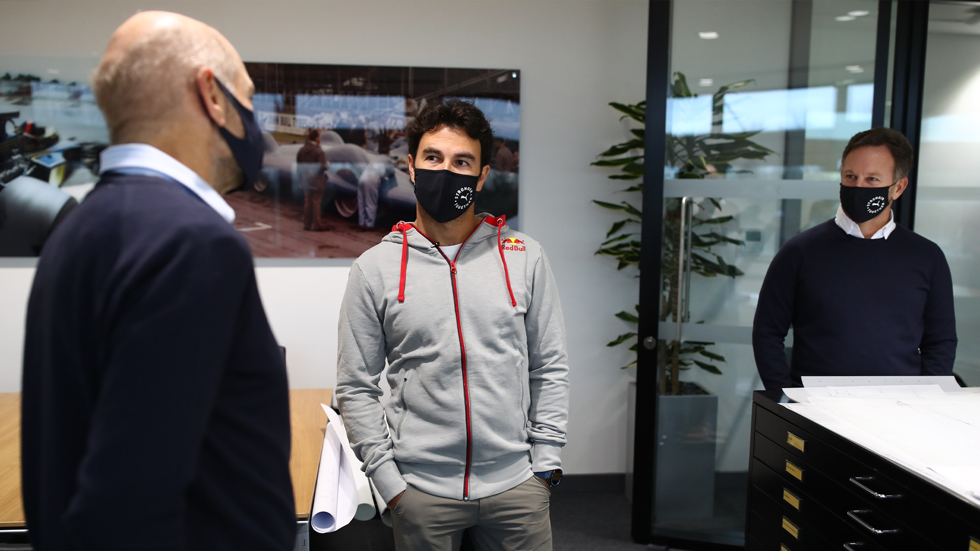Sergio Perez meets Adrian Newey and Christian Horner at the Red Bull F1 factory in January 2021