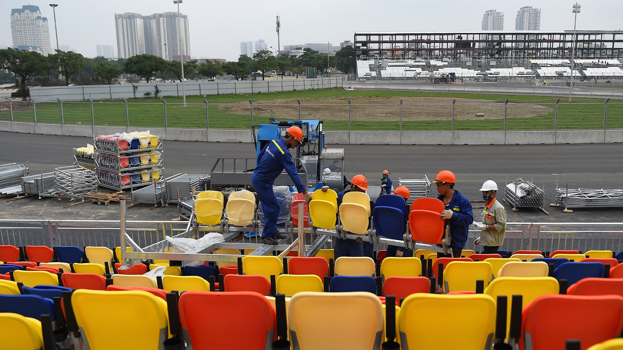 Workers install seats at the Hanoi Street Circuit in Vietnam