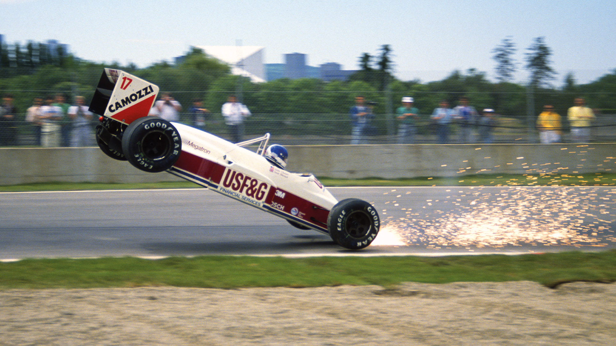 Sparks fly as Derek Warwick crashes his Arrows during practice for the 1988 Canadian Grand Prix