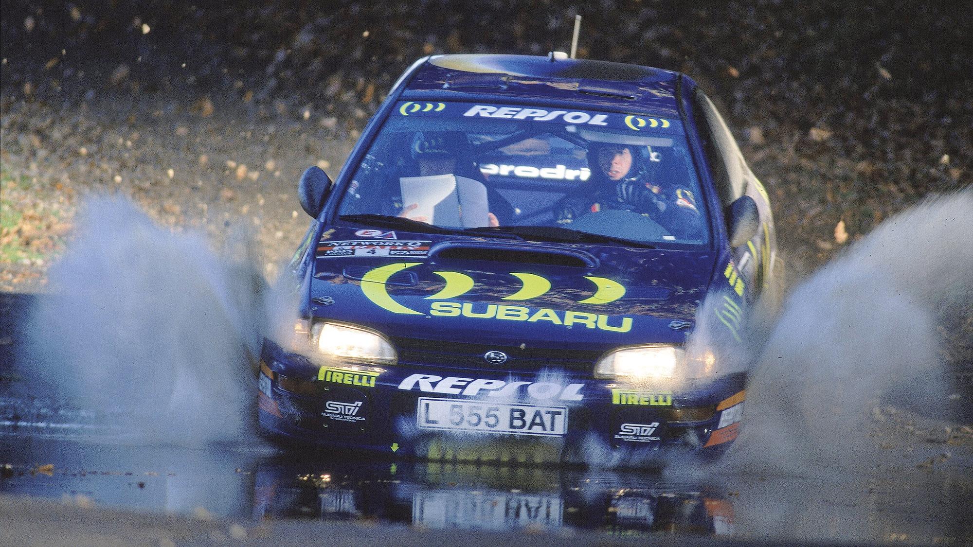 Subaru of Colin McRae splashes through water on the 1995 RAC Rally