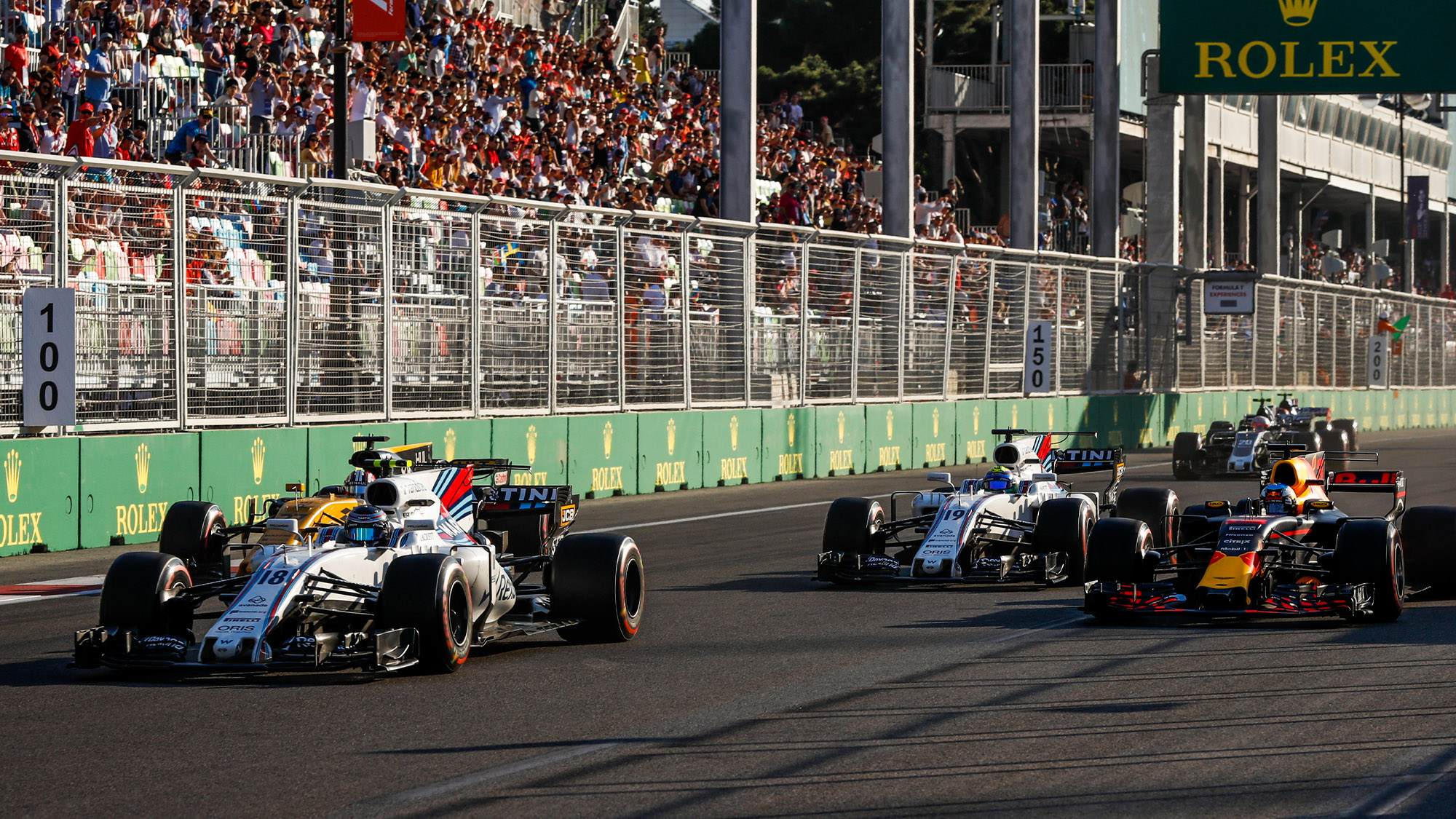 Daniel Ricciardo passes Hulkenberg Massa and Stroll at the 2017 Azerbaijan Grand Prix