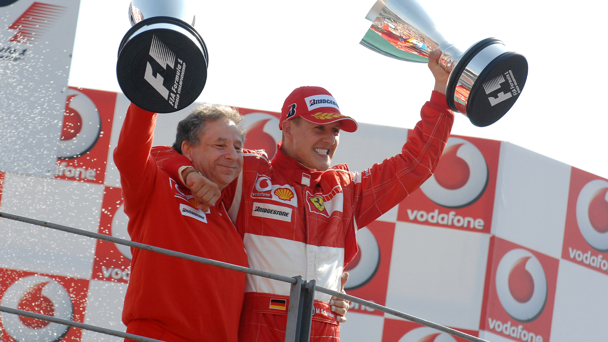 Jean Todt and Michael Schumacher with trophies in 2006