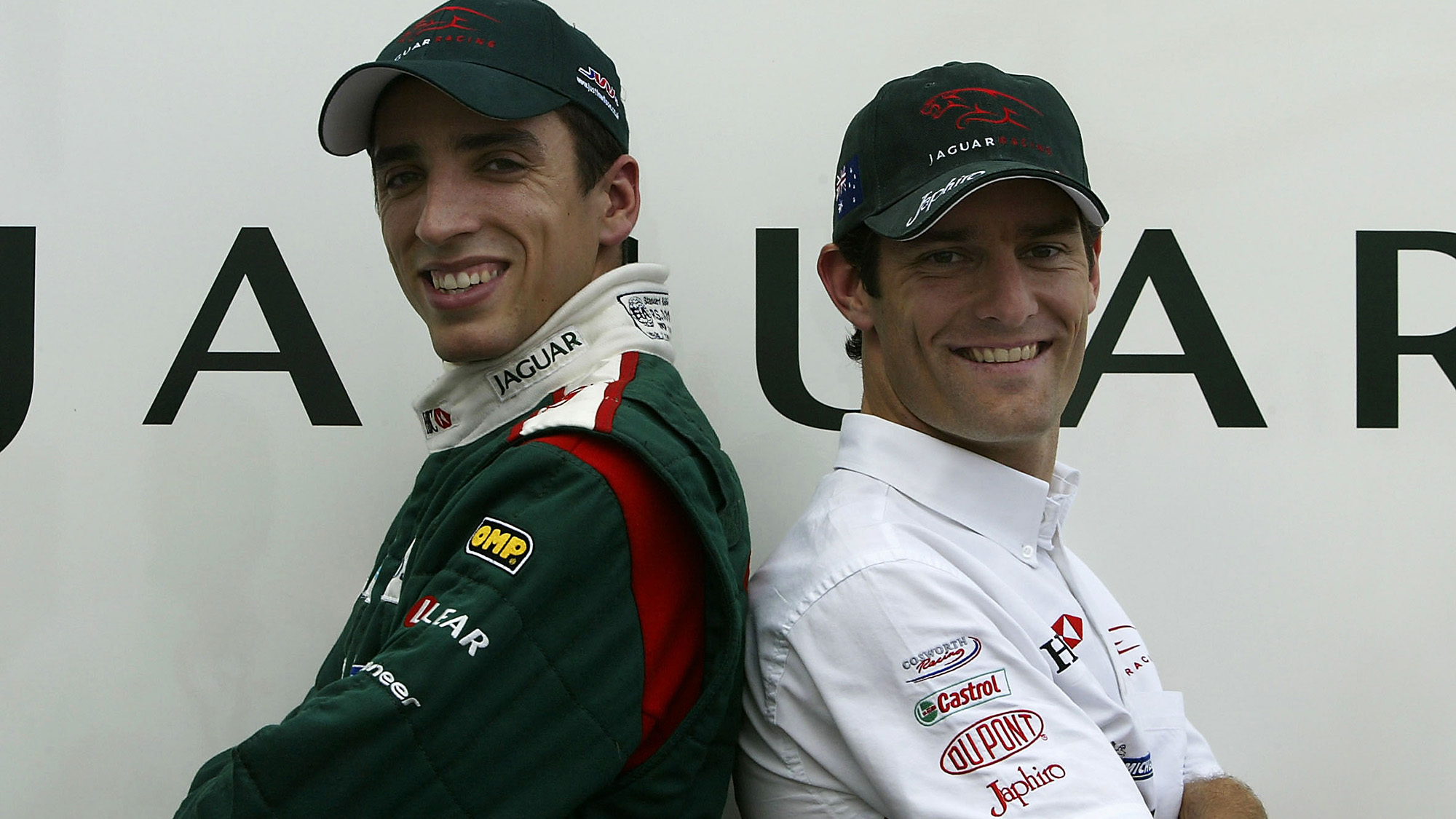 Justin Wilson and Mark Webber pose for a Jaguar F1 team photo in 2003