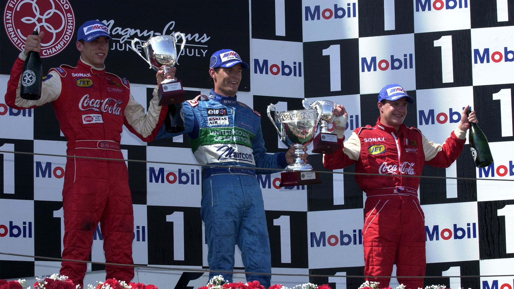 Justin Wilson Mark Webber and Tomas Enge on the podium at Magny Cours after the the 2001 F3000 race
