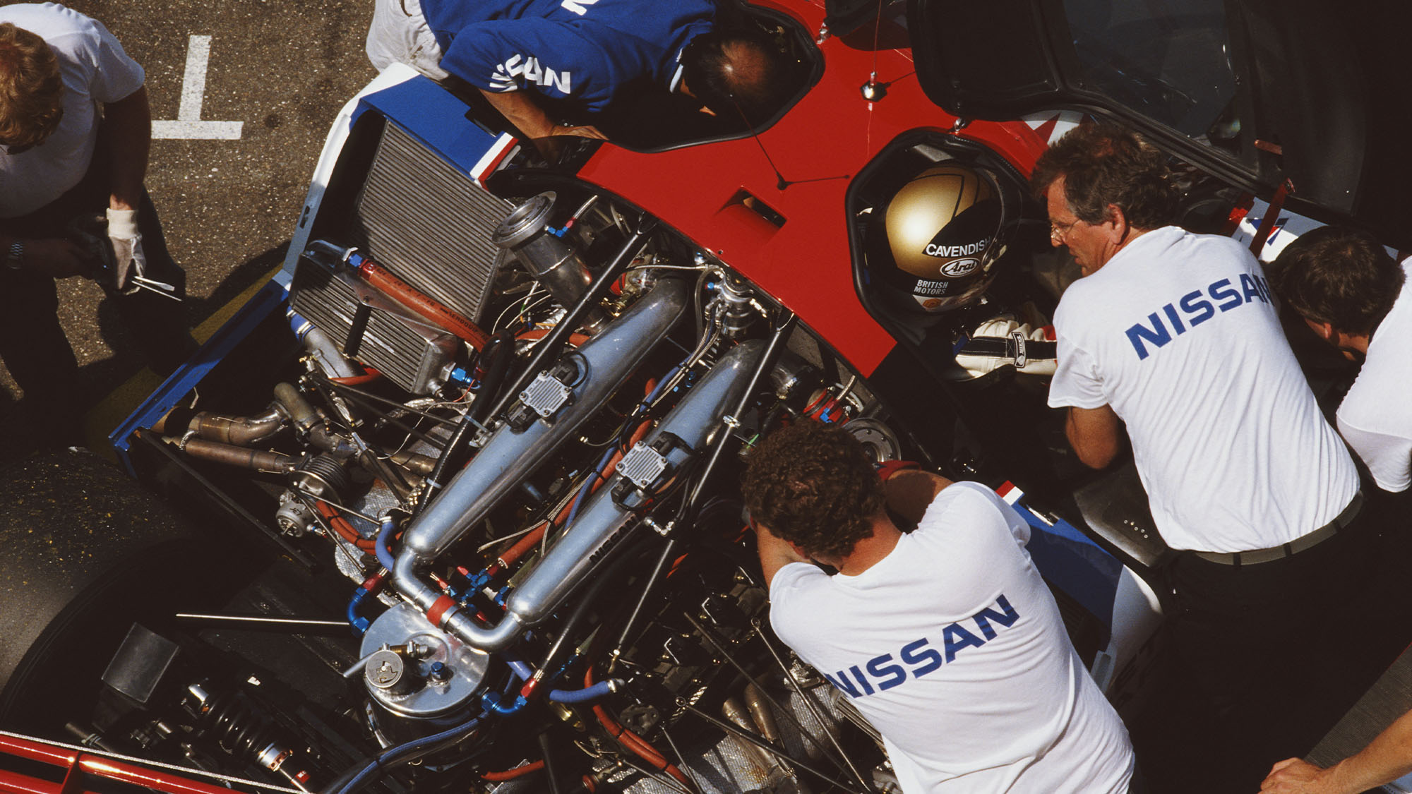 Team Manager Keith Greene talks to Julian Bailey (in car) of Great Britain, driver of the #23 Nissan Motorsports International Nissan R89C during the FIA World Sportscar Prototype Championship Coupe de Dijon on 21st May 1989 at the Circuit Dijon Prenois in Dijon, France.(Photo by Pascal Rondeau/Getty Images)