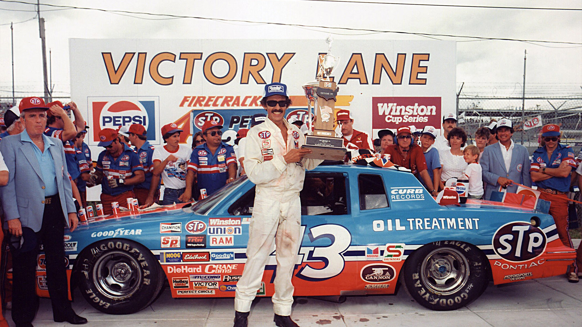 Richard Petty celebrates winning the Firecracker 400 at Daytona in 1984