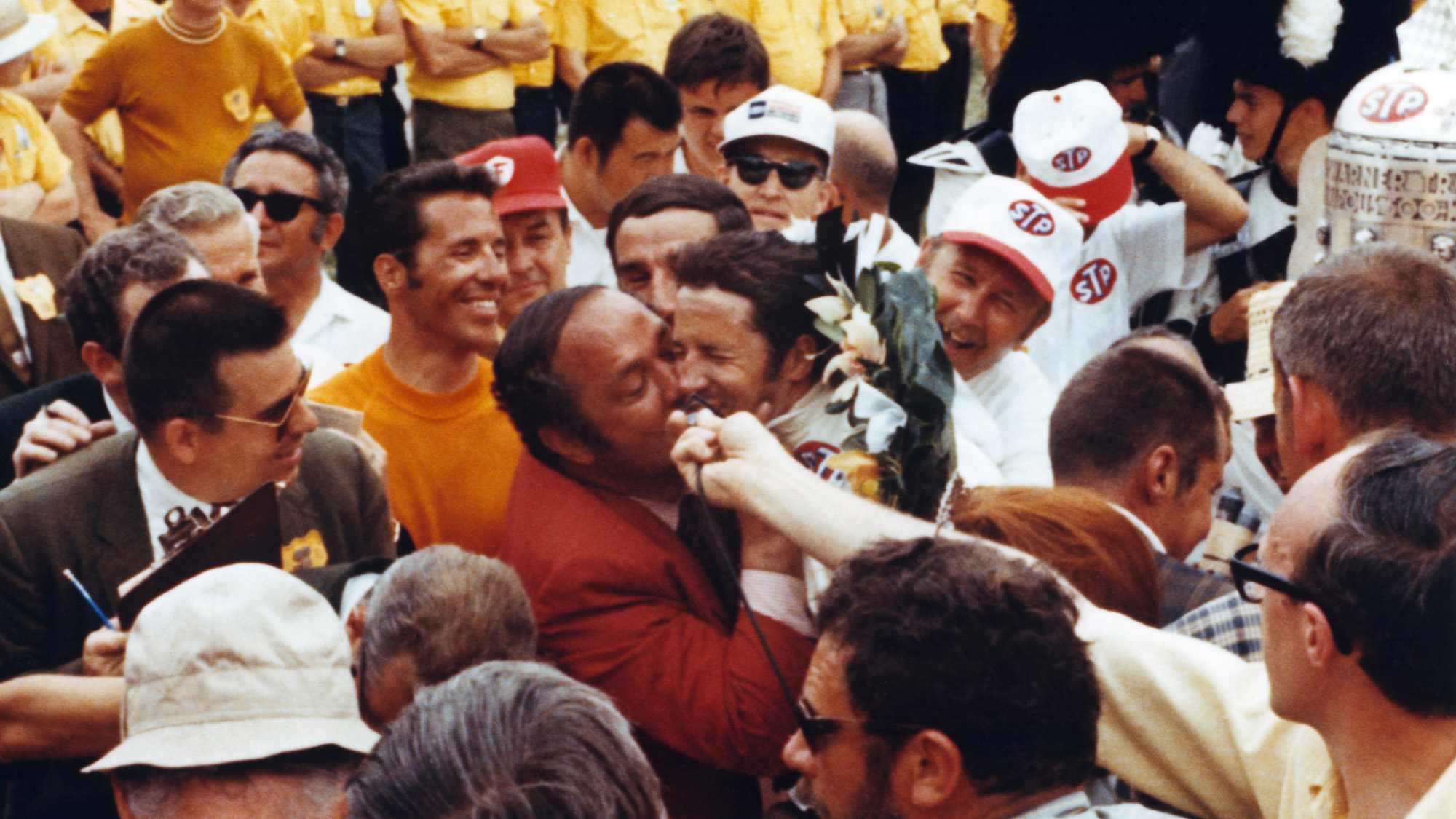 Andy Granatelli kisses Mario Andretti after winning the 1969 Indy 500