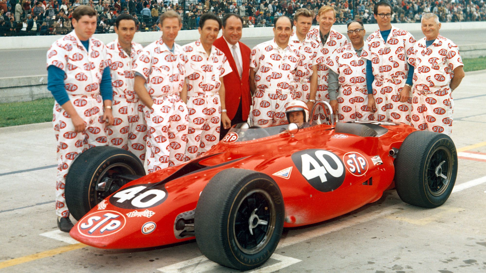 Andy Granatelli with team and Parnelli Jones turbine car before the 1967 Indy 500